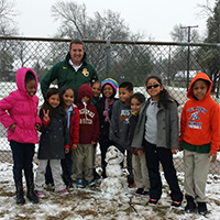 Aaron with some of his students who are seeing snow for the first time!