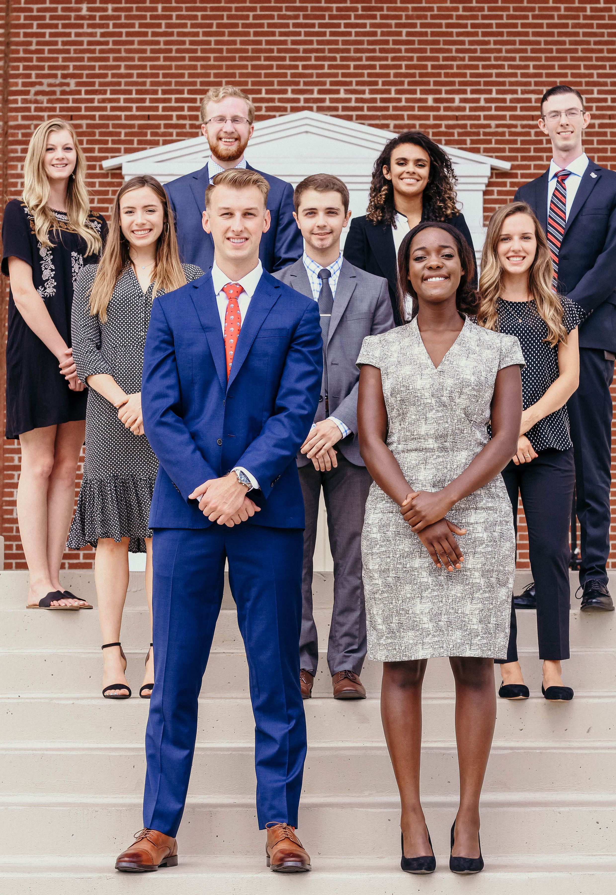 SGA's Executive Cabinet for the 2019 to 2020 school year, standing on the front Demoss steps.