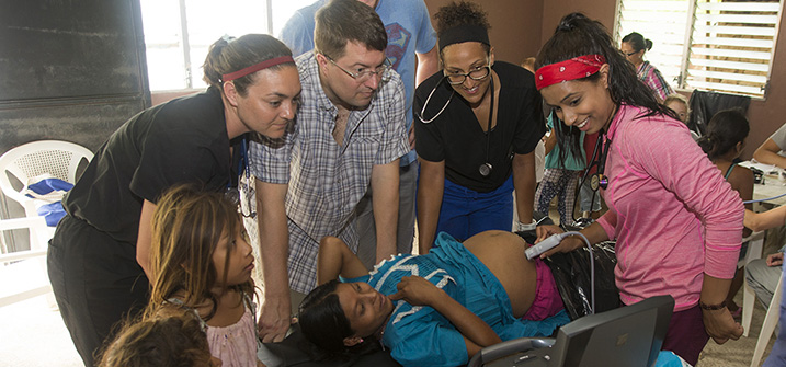 LUCOM student-doctors give ultrasound to pregnant Guatemalan woman.