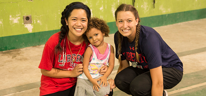 LUCOM student-doctors in Guatemala with child patient.