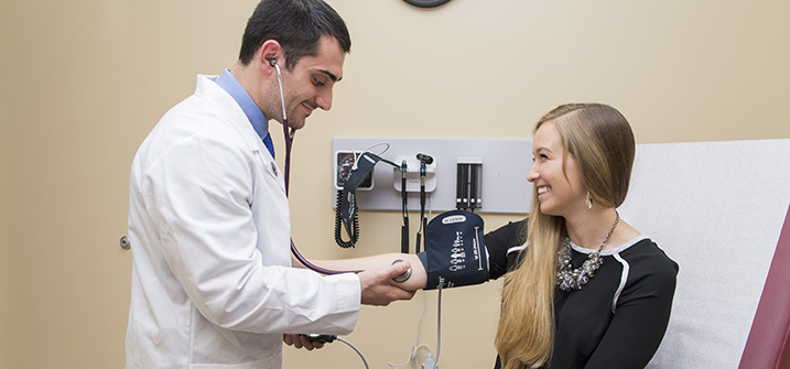 LUCOM student-doctor checks vitals