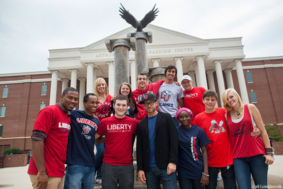 Liberty University students with alumnus TobyMac in front of DeMoss