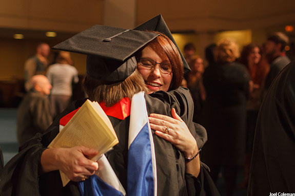Department of Nursing winter pinning ceremony graduates hug.