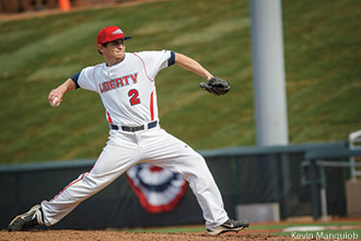 Liberty Baseball player throws a pitch.