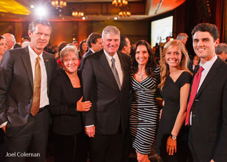 Jerry Falwell, Jr. and his family with Franklin Graham and his wife.