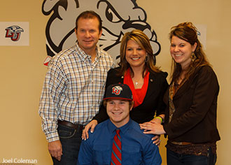 Josh Barrick and his family as he signs to play with the Liberty University baseball team.