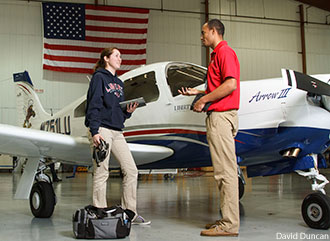 Liberty aeronautics students with a Piper aircraft.