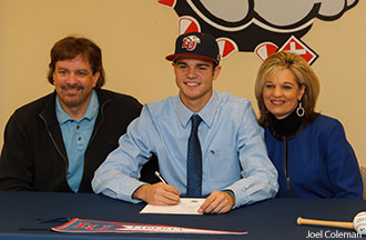 Zach Clinton and his parents as he signs to play with the Liberty University baseball team.