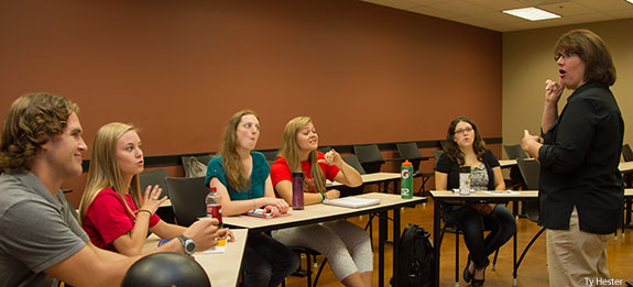 Assistant professor Nicole Thorn instructs students in an American Sign Language & Interpreting course.