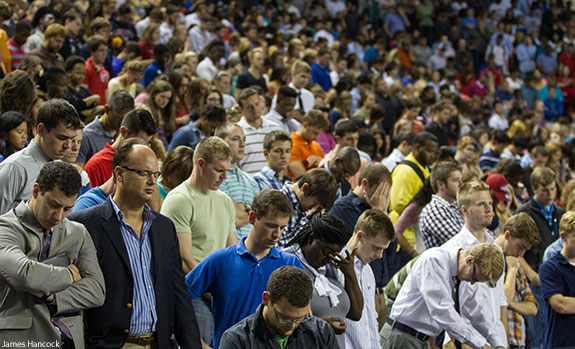 Liberty University students pray during a moment of silence in remembrance of 9/11.