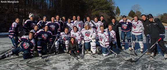 Liberty men's hockey team photo with Becki and Jerry Falwell.