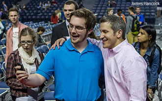 Jon Acuff poses for a selfie with a Liberty University student.