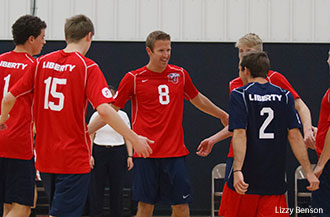 Liberty's men's volleyball team celebrates.