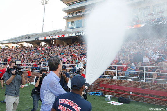 Liberty University President Jerry Falwell soaks the freshman class with a fire hose.