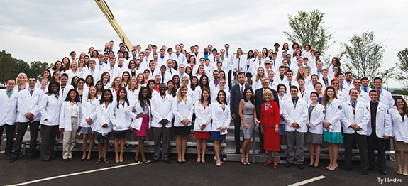 President Jerry Falwell and his wife with Liberty University's medical students.
