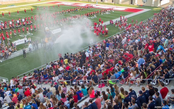 The freshman class is soaked with a fire hose by President Falwell.