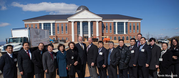 A delegation from China visits the construction site of Liberty University's Center for Medical and Health Sciences.