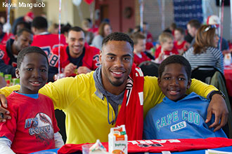 Rashad Jennings clowns with kids at Skills Camp at Williams Stadium.