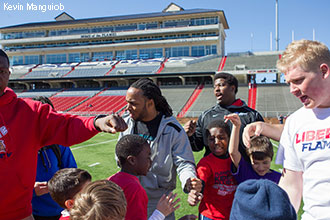 Mike Brown coaches kids at the Skills and Drills Mini-Camp at Williams Stadium.