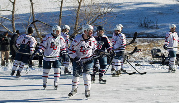 Liberty men's hockey team skates at Falwell family farm lake.