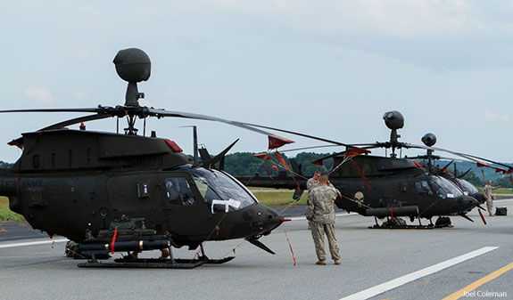 Military helicopters land at Lynchburg Regional Airport.