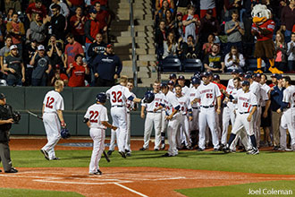 Liberty Baseball Stadium celebration at home plate with Sparky in background.