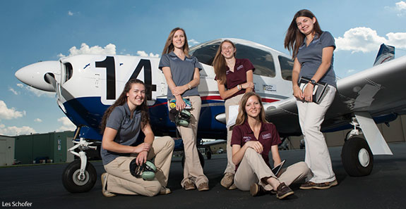 Liberty Belles flight team in front of one of the Piper Arrow 28s they will use.
