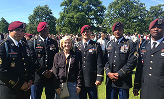 Liberty graduate Ashley Sears with a group of U.S. soldiers.