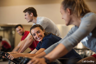 Students participate in a group cycling class at the Liberty Student Union.