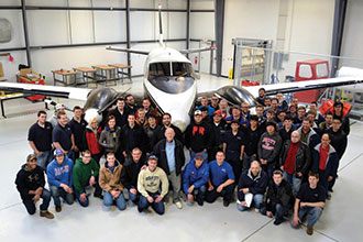Aeronautics students with Sherwin Cook in a Liberty hangar.
