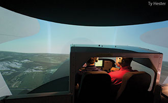 A Liberty student and instructor in a flight simulator.