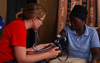 A Liberty student provides nursing aid in Rwanda.