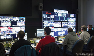 LFSN staff produces a Flames basketball game.