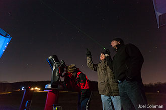 Students and an instructor stargaze at Liberty University's Astronomical Observatory.