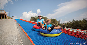 Guests enjoy one of the new tube runs at Liberty Mountain Snowflex Centre.