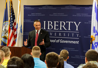 Dan Bongino, a former member of the Secret Service, spoke to students at the Helms School of Government.