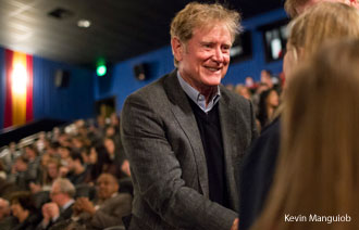 Hollywood director Randall Wallace greets students in the theater before the screening on Wednesday.