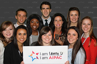 Liberty University Stand With Israel Club members pose with Penny Nance.