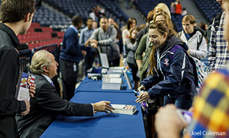 Mike Reagan signs books for Liberty University students.