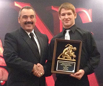 Liberty freshman Ryan Diehl receives the NCWA wrestler of the year award.