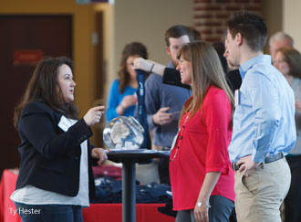 Law school staff greet alumni at a breakfast reception on Saturday, March 22.