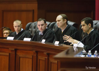 School of Law alumni serve on a panel of judges for a moot court tournament on Saturday, March 22.