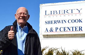 Sherwin Cook outside the newly named Liberty University Sherwin Cook A&P Center.