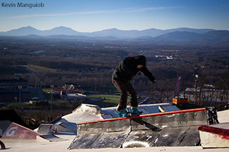 A snowboarder rides on the rails at the Liberty Mountain Snowflex Centre.