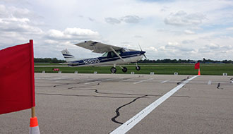 Liberty University SOA's Cessna-150 aircraft lands during NIFA competition.