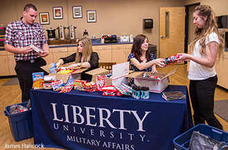 Liberty University's Office of Military Affairs assembles care packages for U.S. Troops who are studying online through Liberty.