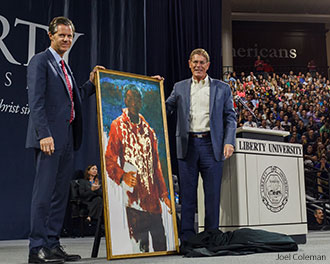 President Jerry Falwell accepts a painting depicting the last Bible translator.