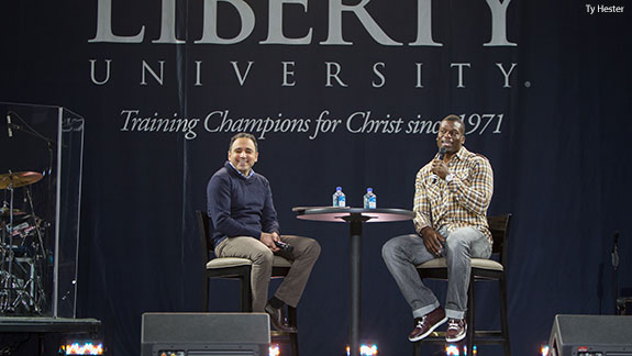 NFL tight end Ben Watson, alongside David Nasser, speaks during Liberty University Convocation.