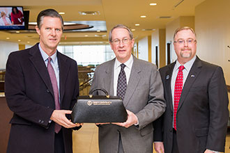 Congressman Bob Goodlatte is presented with a token of appreciation following his visit to LUCOM.