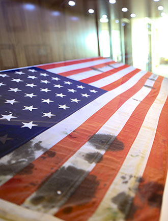 A U.S. flag recovered, bullet scarred and oil-stained, after the attack on Pearl Harbor is on display in the Liberty University Jerry Falwell Library.